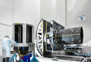 The main body of NASA's Psyche spacecraft, called the Solar Electric Propulsion (SEP) Chassis, is in a clean room at Maxar Technologies in Palo Alto, California, where a technician prepares to integrate part of the electric propulsion system onto the chassis. Credit: NASA/JPL
