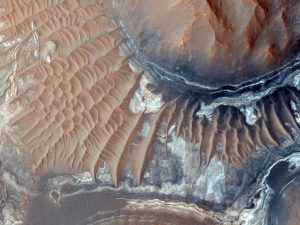 CRISM observations of this region of the Noctis Labyrinthus formation have shown indications of iron-bearing sulfates and phyllosilicate (clay) minerals. CRISM is another instrument on the Mars Reconnaissance Orbiter. Credit: NASA