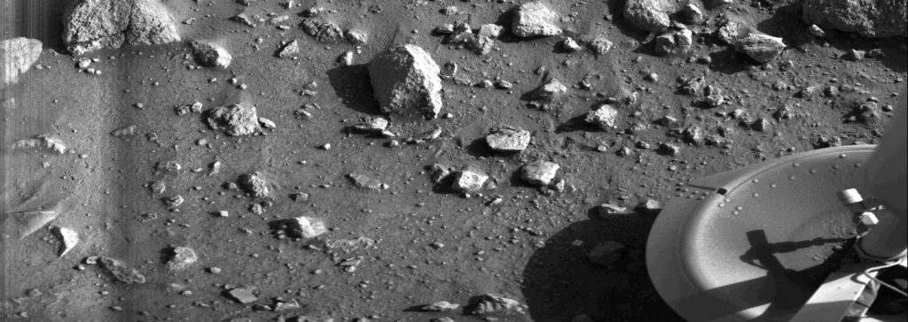 Taken by the Viking 1 lander shortly after it touched down on Mars, this image is the first photograph ever taken from the surface of Mars. It was taken on July 20, 1976. Credit: NASA