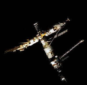 Backdropped against the darkness of space, Russia's Mir Space Station is seen from the aft flight deck window of the Space Shuttle Atlantis. Credit: NASA
