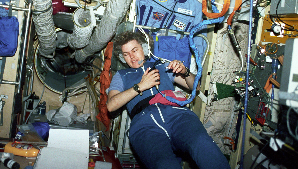 NASA astronaut Shannon W. Lucid communicates with the ground support team inside the Core Module of the Russian Mir Space Station in 1996. Lucid, who holds a Ph.D. in biochemistry, spent six months on Mir performing experiments, setting a record for longest female space flight. Credit: NASA