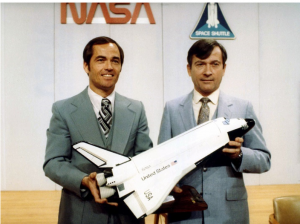 Crippen, left, and Young pose for photographers with a model of Space Shuttle Columbia following a press conference. Credit: NASA