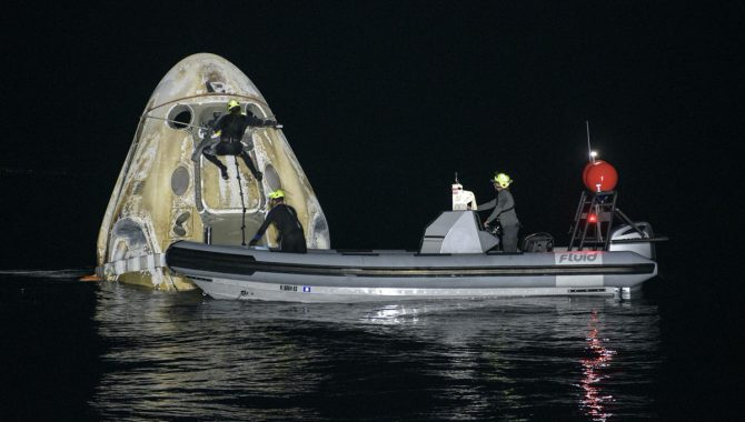 Support teams work around the SpaceX Crew Dragon Resilience spacecraft shortly after it landed with NASA astronauts Mike Hopkins, Shannon Walker, and Victor Glover, and Japan Aerospace Exploration Agency (JAXA) astronaut Soichi Noguchi aboard in the Gulf of Mexico off the coast of Panama City, Florida, Sunday, May 2, 2021. Credit: NASA/Bill Ingalls