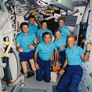 The seven crew members for STS-40 pose for an in-space portrait on the Space Shuttle Columbia's mid-deck. Left to right, in front are F. Andrew Gaffney, Sidney M. Gutierrez, Rhea Seddon and James P. Bagian; in back, Bryan D. O'Connor, Tamara E. Jernigan and Millie Hughes-Fulford. Credit: NASA