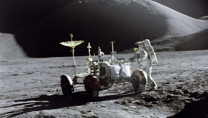 """Apollo 15 Lunar Module Pilot James Irwin works at the Lunar Roving Vehicle during the first Apollo 15 lunar surface extravehicular. The folding """"manned spacecraft on wheels"""" was a game changer for the Apollo Program, freeing astronauts to explore larger swaths of the lunar surface. This photograph was taken by Mission Commander David Scott. Credit: NASA"""