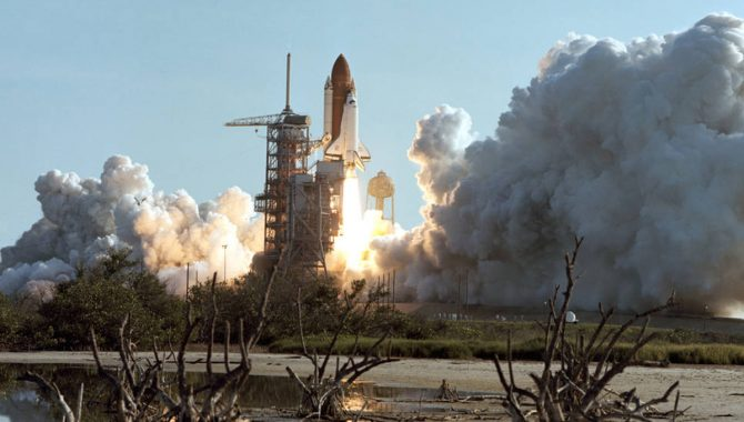 The Space Shuttle Discovery launches on its first flight, STS-41-D, on August 30, 1984, 37 years ago this month. The crew deployed three satellites and heard knocking at the payload bay doors. Credit: NASA