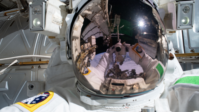 """European Space Agency astronaut Luca Parmitano took this """"space-selfie"""" during an extravehicular activity (EVA) at the International Space Station (ISS) in 2019. Six years earlier, Parmitano's helmet dangerously filled with water during an EVA at the ISS. Credit: NASA"""