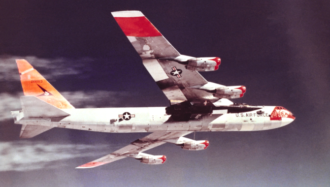 An NB-52 mothership carries an X-15 aloft for a research flight on April 13, 1960, Maj. Gen. Robert M. White's first flight in the hypersonic rocket plane. The X-15s reached speeds well beyond 4,000 mph and altitudes that qualified eight pilots for astronaut wings. Credit: NASA